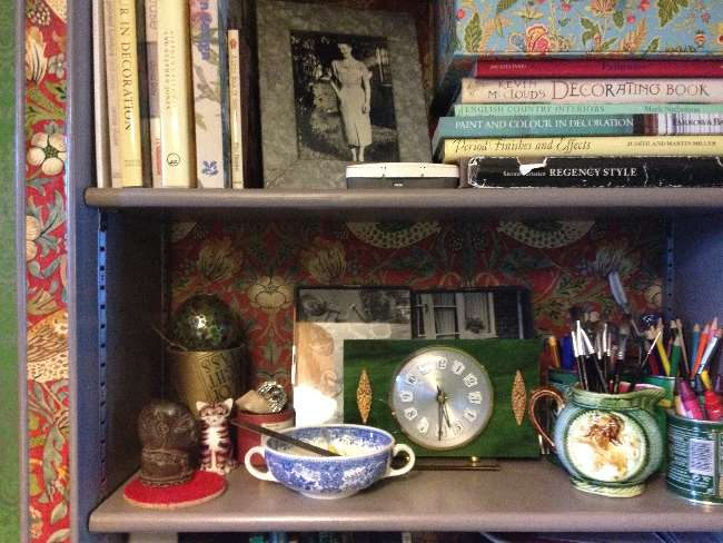 Detail of shelf contents, including bowl and books