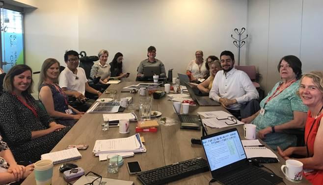 IDAG members in an office meeting