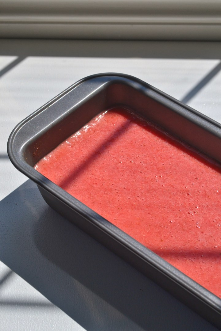liquid strawberry lime granita in a loaf tin prior to freezing