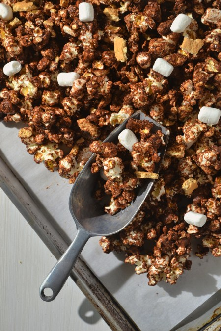 easy s'mores popcorn mix on a baking sheet