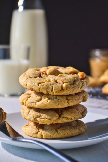 Chewy peanut butter cookies stacked on a plate