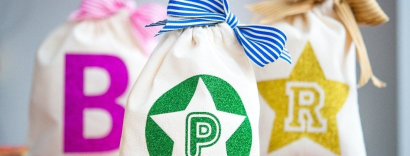 Bright and colourful personalised fabric party bags by Make it Friday. Party Bag ideas by Made By Me Craft Parties