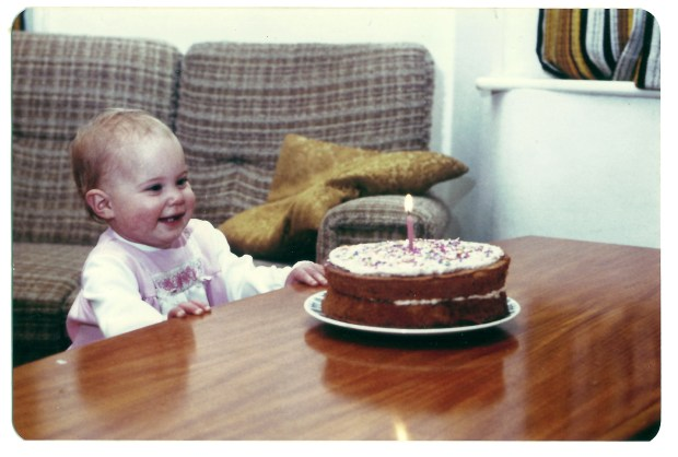 Baby with cake and candle December birthdays