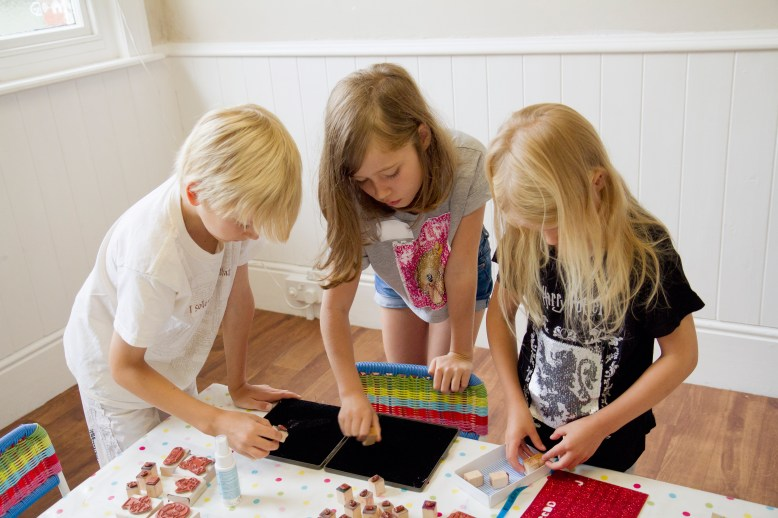 Children making potion and spell books as part of the witch and wizard craft party