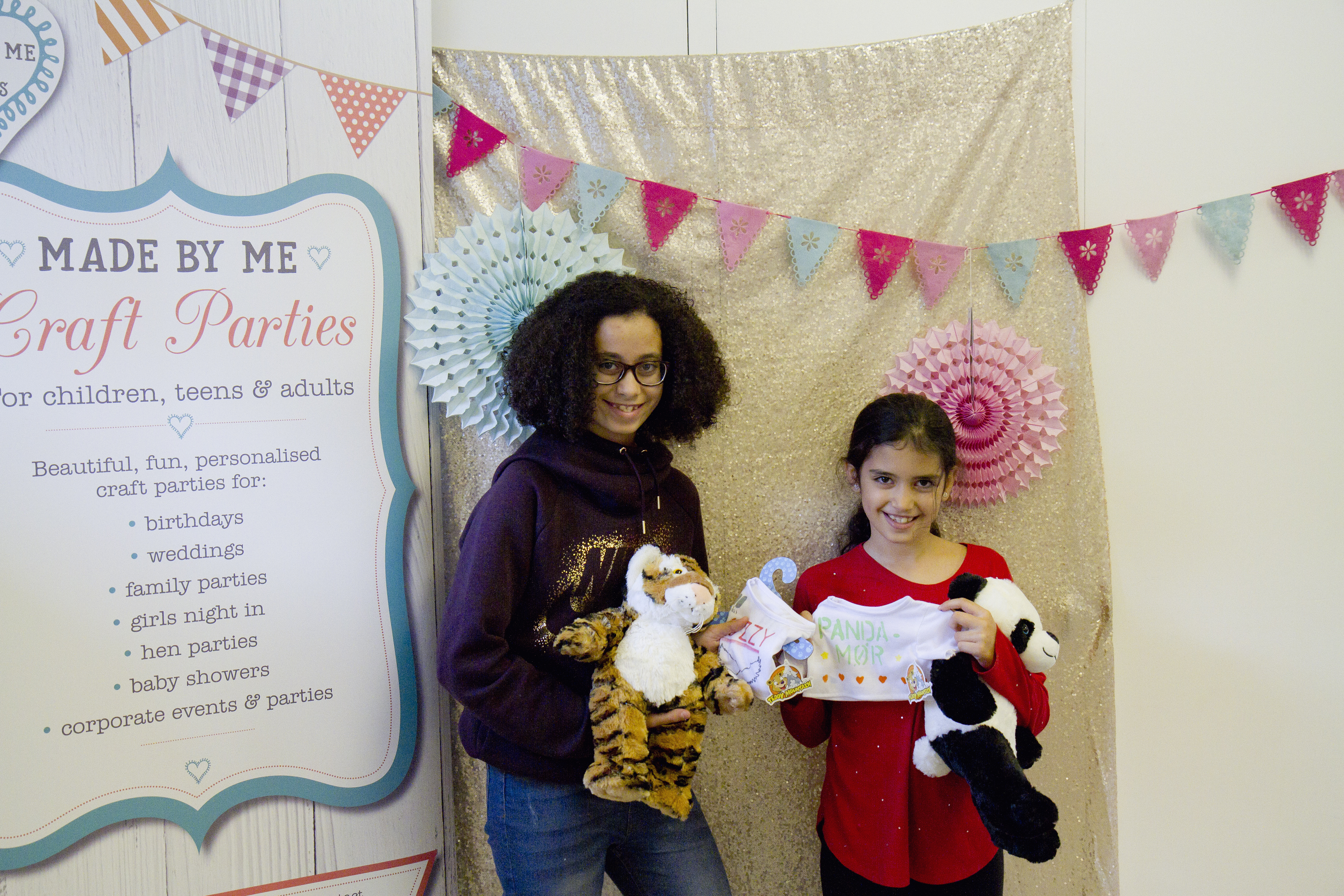 Teddy bear making party. 2 girls posing with their bears made at a Made By Me Craft Party