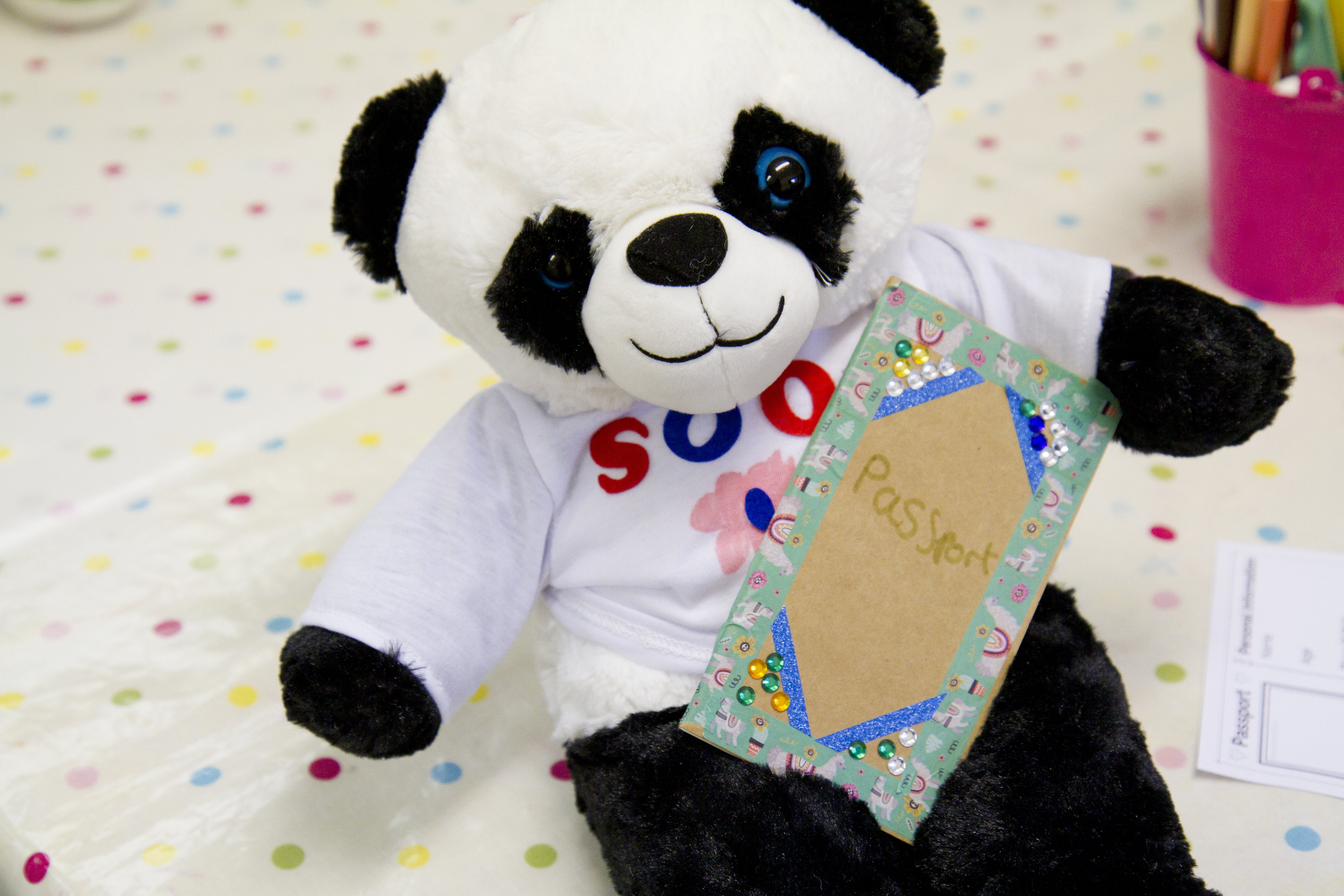Teddy bear making party by Made By Me Craft Parties. Close up of panda teddy bear with t-shirt and passport made by a child at the party