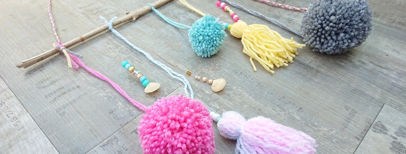 pom pom and tassel wall hanging