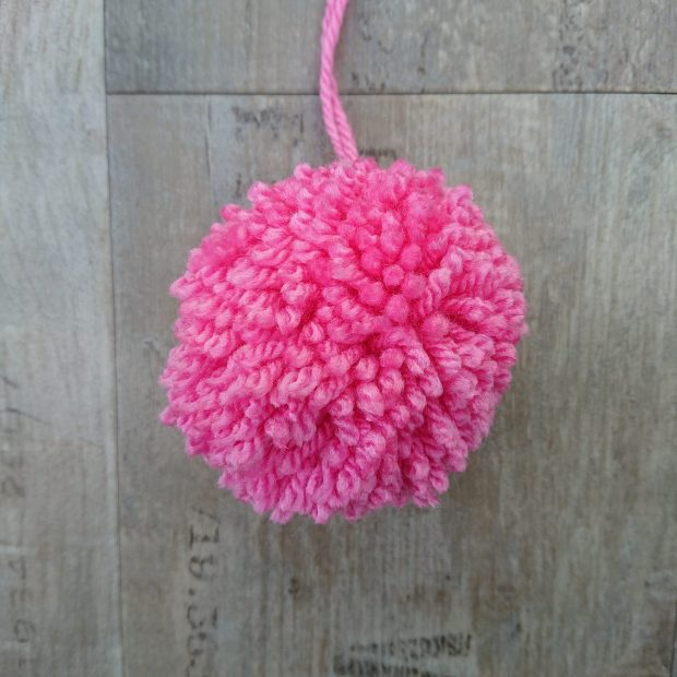 Pink pom pom made from wool