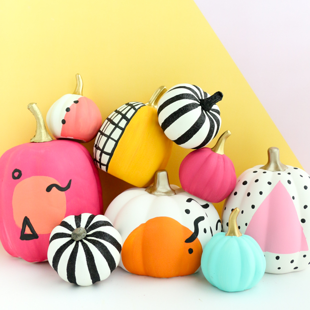 A pile of brightly painted pumpkins