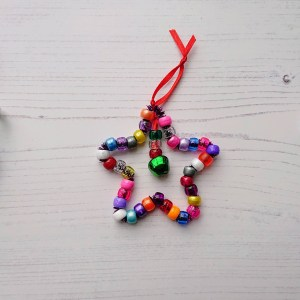 A mini Christmas craft kit containing 3 DIY Christmas decorations made from a kit. Icicle, star and candy cane