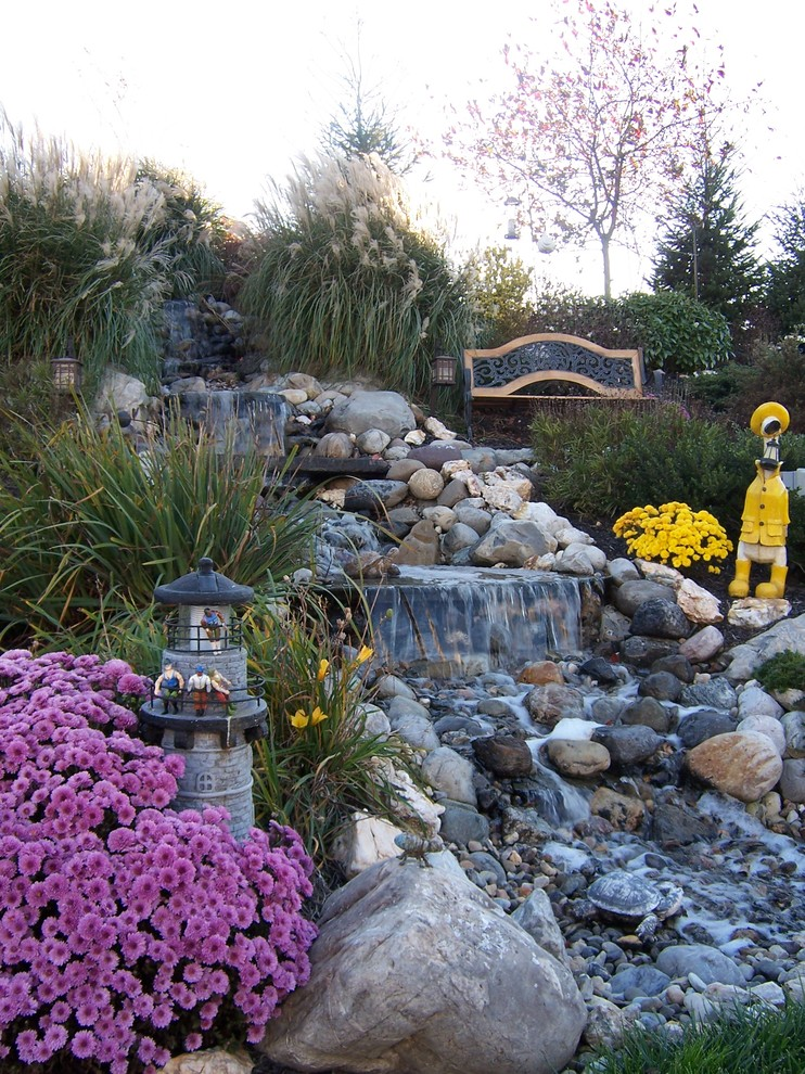 Baroque duck river textile in Landscape Traditional with Pebbles  next to Garden Fountain  alongside Rock Waterfall  and Pondless Water Feature