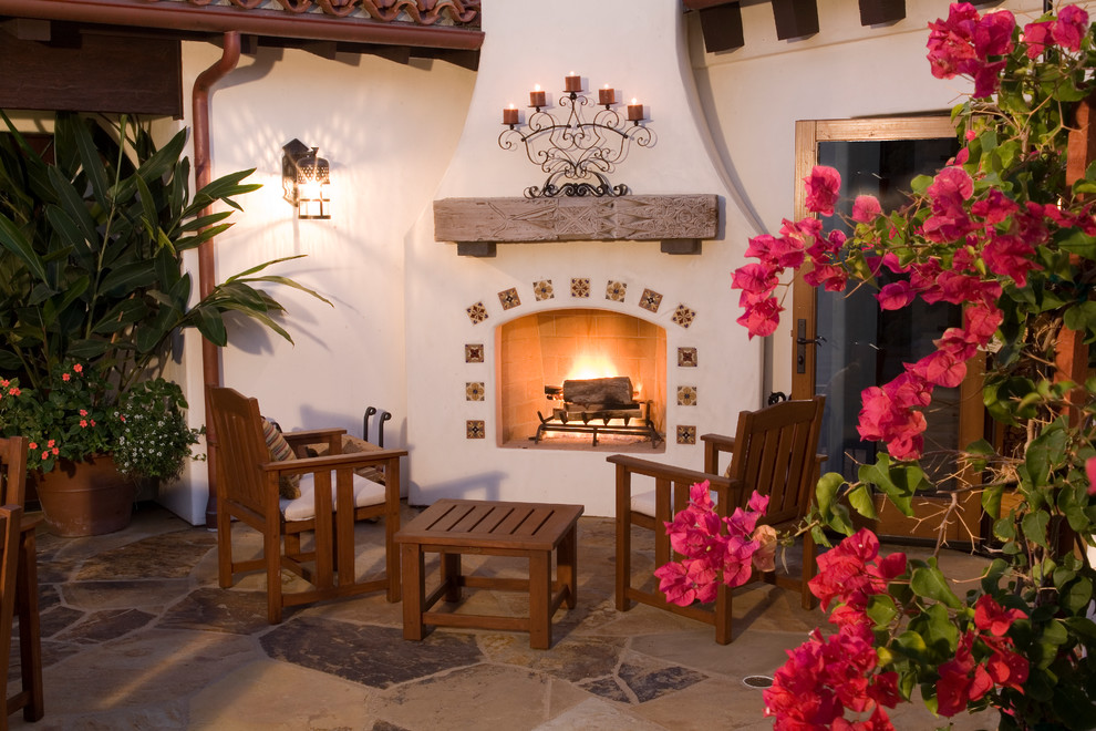 Glamorous fireplace candelabrain Patio Mediterranean with ... on Mexican Patio Ideas  id=48811
