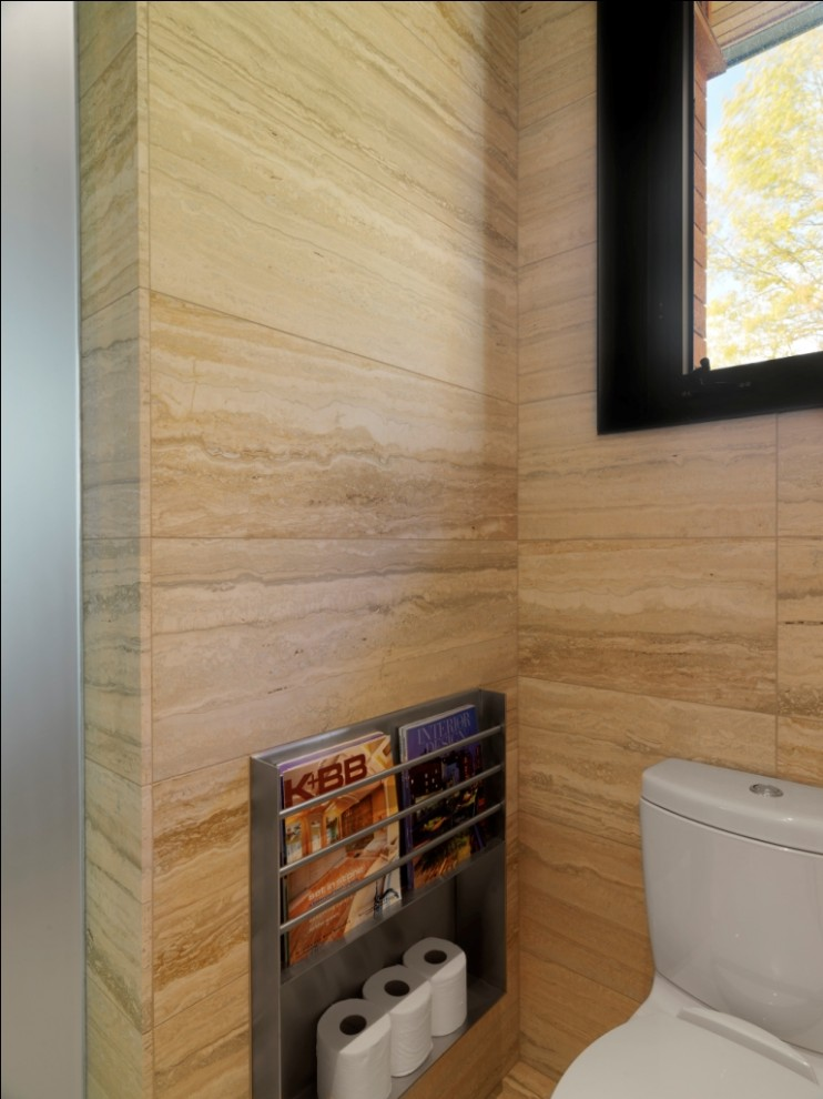 innovative wall mounted magazine rack in bathroom rustic with travertine looking porcelain floor next to toilet alongside over toilet storage and small bathroom toilet