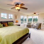 Splashy king size sleigh bed in Bedroom Contemporary with Best Bedroom Ceiling Fan next to Framed Sea Fan Coral alongside Windows Above Bed and Ceiling Fan