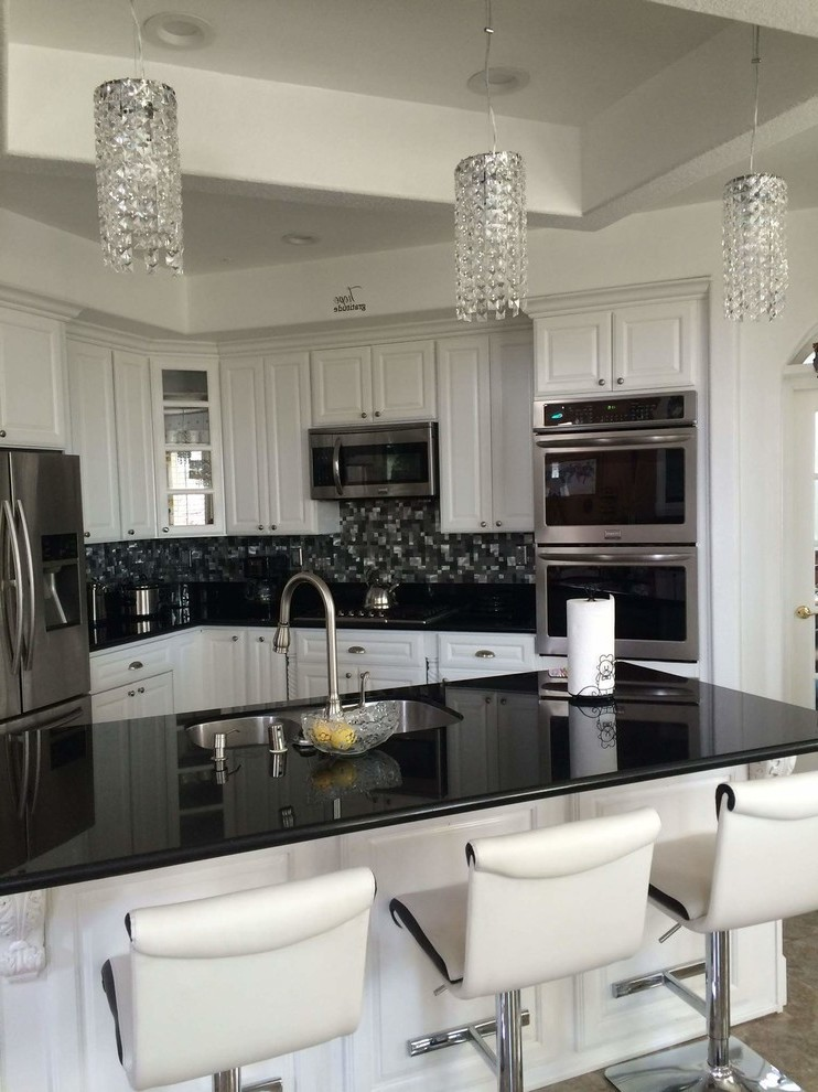 black galaxy granite kitchen mediterranean with saddle on kitchen design ideas photos and videos hgtv id=34294