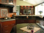 Burnt Orange Wall with Dark Granite Counter Multi Level Counters Countertops Light Pendant