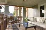Sun Porch Furniture with Water View White Roof Overhang Ceiling Fan Wood Coffee Table