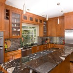 portland granite countertop images with contemporary dishwashers kitchen transitional and wood floors