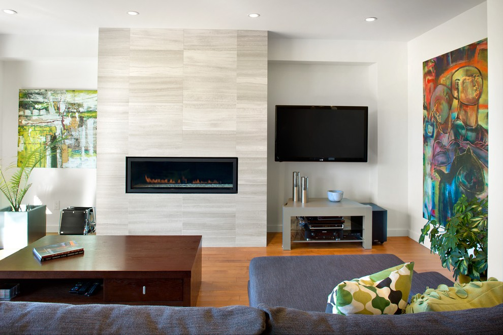 Outstanding Natural Stone Fireplace Surround With Television Over Wingback Armchair