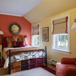 new york pastel colored rooms with brass swing arm wall lamps bedroom traditional and blinds round mirror