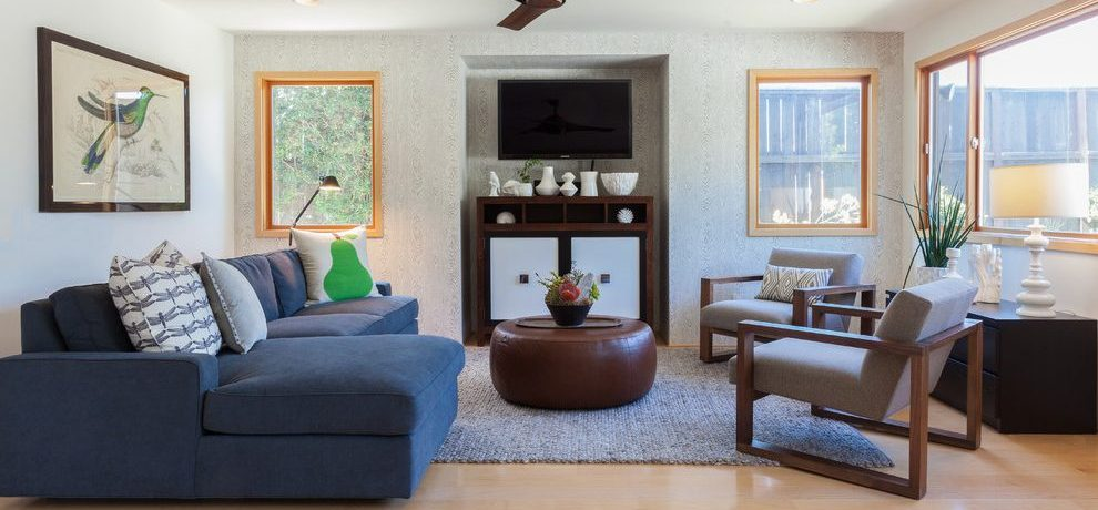 Blooming blue leather sofa Transitional Family Room in Los Angeles with navy velvet couch and Navy