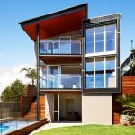 Lovely metal and glass etagere Contemporary Exterior in Sydney with aneeta frameless windows beige siding