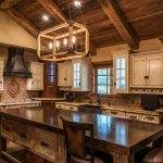 Fabulous fireplace stacked stone Rustic Kitchen in Kansas City with kitchen vent hood and steel range