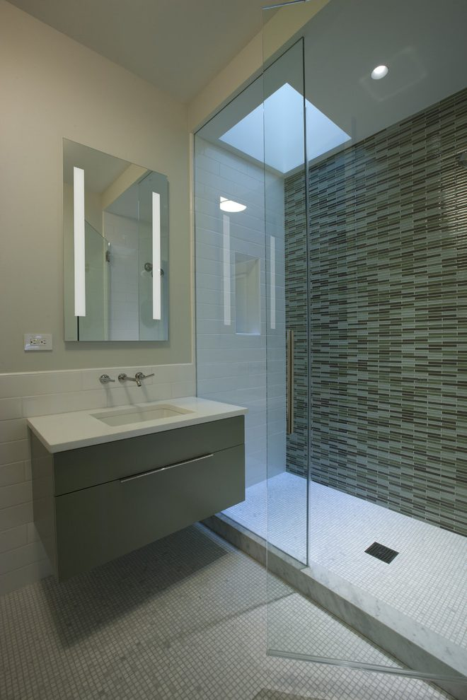 Imaginative bathroom wall design in with stone cleaners and glass tile shower