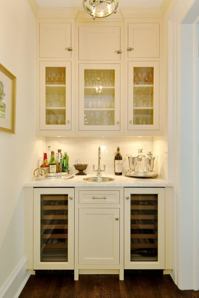 sink small round and white subway tile wall