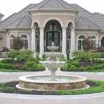 Splendid pondless water feature in with covered front door and