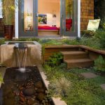 Wonderful pondless water feature in with glass doors and sliding