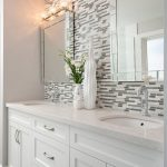 Extraordinary faux bois mirror Transitional Bathroom in Vancouver with marble mosaic tile and Stonington Gray