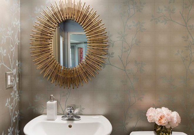 Magnificent metalic wallpaper in with vanity mirror and floral arrangement