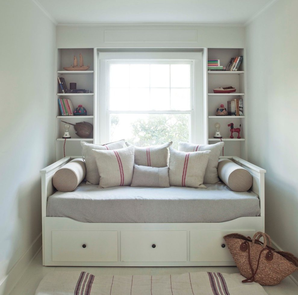 Open Shelving And Built-in Shelves Built-in Shelves Double Hung Windows Flat Weave Rug Open Shelving Red Stripe Under Bed Drawers White Floor Walls