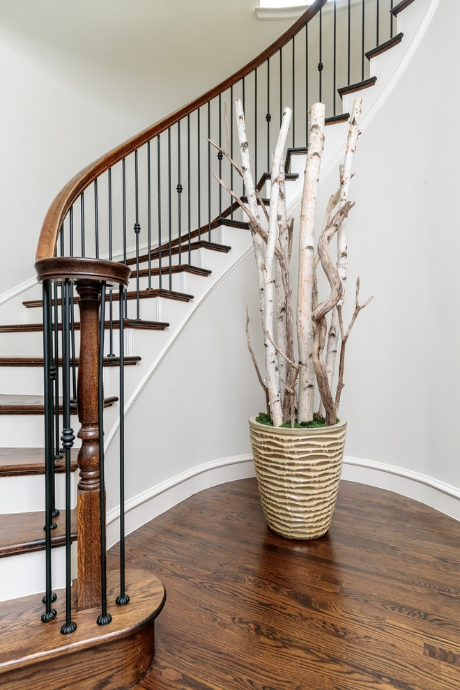 Dallas Wrought Iron Spindles Traditional Staircase Black Stair | Black Banister White Spindles | Black Railing | Wainscoting | White Painted Riser | Benjamin Moore Stair Railing | Baluster Curved Stylish Overview Stair