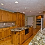 Dishy Knotty Pine Kitchen Cabinets Kitchen Traditional With Gold Granite And Beaten Copper Sink Beaten Copper Sink Black Granite Brick Backsplash