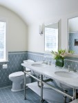 Terrific Ann Sacks Bathrooms Bathroom Traditional with Wall Sconce Porcelain Knobs Barrel Vault Tile Wainscot Chrome Console Marble Counter Framed Mirrors Double Sink