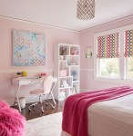 Good-looking Fluffy Chair Transitional Full Renovation and Custom Furnishings with Pink Blanket Light Walls Colorful Roman Shades White Rail Task Bookshelf Area Rug