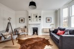 Good-looking Ikea Mirrors Ideas Living Room Scandinavian with Wall Lamps Victorian Fireplace Mounted Cabinet Black and White Grey Armchair Lights Animal Skin Mantel Mirror