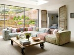 Amazing Playroom Sofa Living Room Contemporary with Blue Cushions Gray Carpet String Lights Terraced House Woven Colorful Sectional Large Windows Louvered Doors Wheeled Coffee Table Green