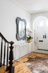 Awesome Foyer Table with Mirror Entry Transitional Animal Skin Rug Newel Post White Metal Door Black Arched Console