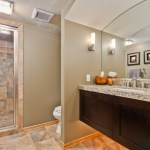 Dishy Colors Of Travertine Bathroom Transitional With Wood Baseboard And Wicker Laundry Hamper Arched Bathroom Mirrors Mirror Vanity Sconce Beige
