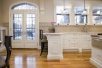 Dishy Sea Glass Backsplash Kitchen Traditional with Double Hung Windows Wood Flooring Subway Tiles Window Sheers Arched Top Transom French Doors Stained Glass Transom Natural Light