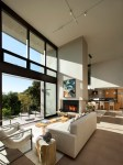 Extraordinary Double Sided Sofa Living Room Contemporary with Picture Windows High Ceilings Beige Live Edge Coffee Table Side Chair Open Floor Plan Concept Double-sided Fireplace