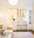 Good-Looking Bookshelf in Kitchen Kitchen Contemporary with Glass Front Cabinets Sheer Window Treatment Glass-front Cabinets Open To Living Place Settings White Pendant Lights
