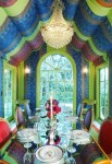Imaginative Hot Pink Room Dining Room Eclectic with Neoclassical Chairs Radius Window Chandelier Arched Mirrored Glass Table Green Velvet Vibrant Purple Place Settings Electric Blue