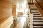 Magnificent Tongue and Groove Walls Staircase Traditional with Ceiling Fan White Painted Wood Ceiing Paneling Floor Dark Stained Treads Tonge Seating Area
