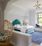 Magnificent Brown and Purple Bedroom Bedroom Beach Style with Baseboards Gold Chandeleir Patterned Rug indoor Swing Chair Lavender Walls Turquoise Bed Tray Ceiling Arched Doorway Bird Pillow