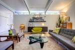 Sparkling Creative Coffee Table Living Room Midcentury with Wood Flooring Sloped Ceiling Wall Shelves Floating Exposed Beams Midcentury Modern Icons Houseplants Green