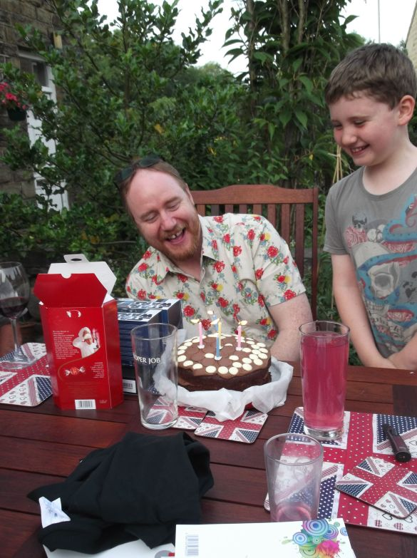 Mr P in his new shirt, with his cake, decorated by small boys.